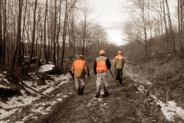 bird hunters walking on trail