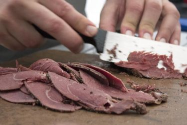 Goose Pastrami Sandwich meat sliced at Camp Chef Cook-off