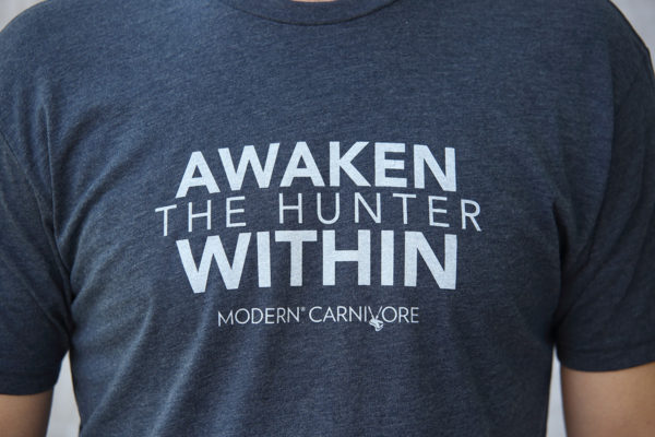 Awaken The Hunter Within T-shirt Men's Blue logo closeup