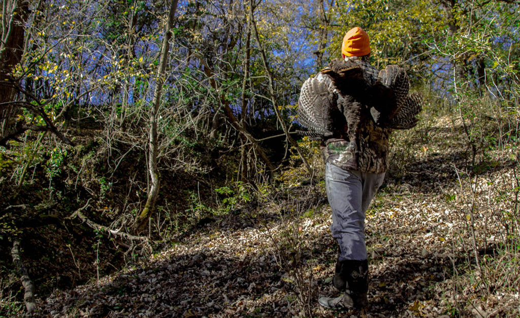 Jamie Carlson carrying wild turkeys Modern Carnivore