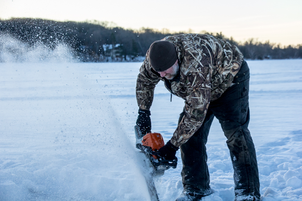 ice-fishing-spearing-chainsaw