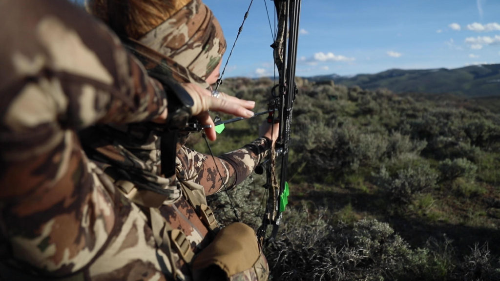 Jessi Johnson, a new hunter, takes aim with her bow and arrow
