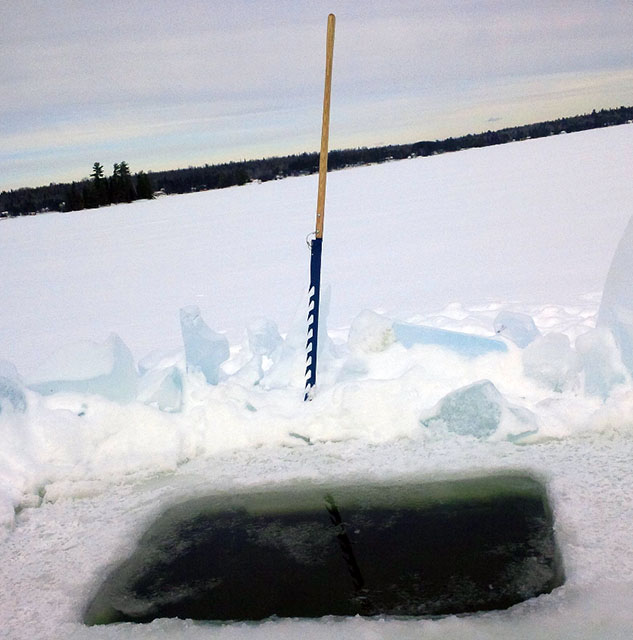Fish's-saw-cut-hole-in-ice-darkhouse-spearing-hardwater-hunters-modern-carnivore